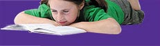 Image of girl laying down reading